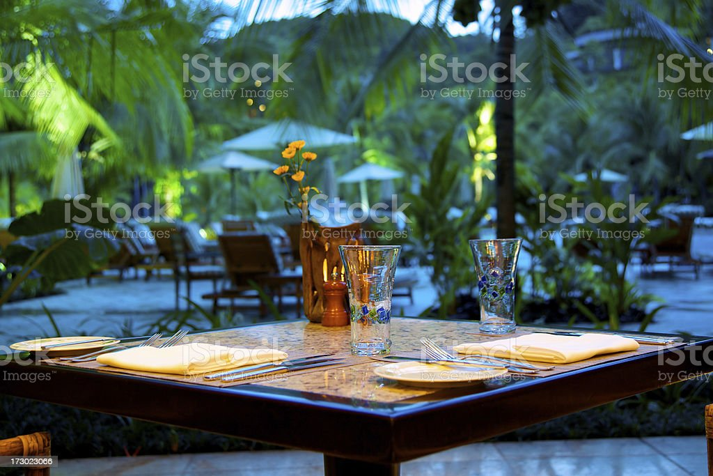 Outdoor dining in tropical resort royalty-free stock photo