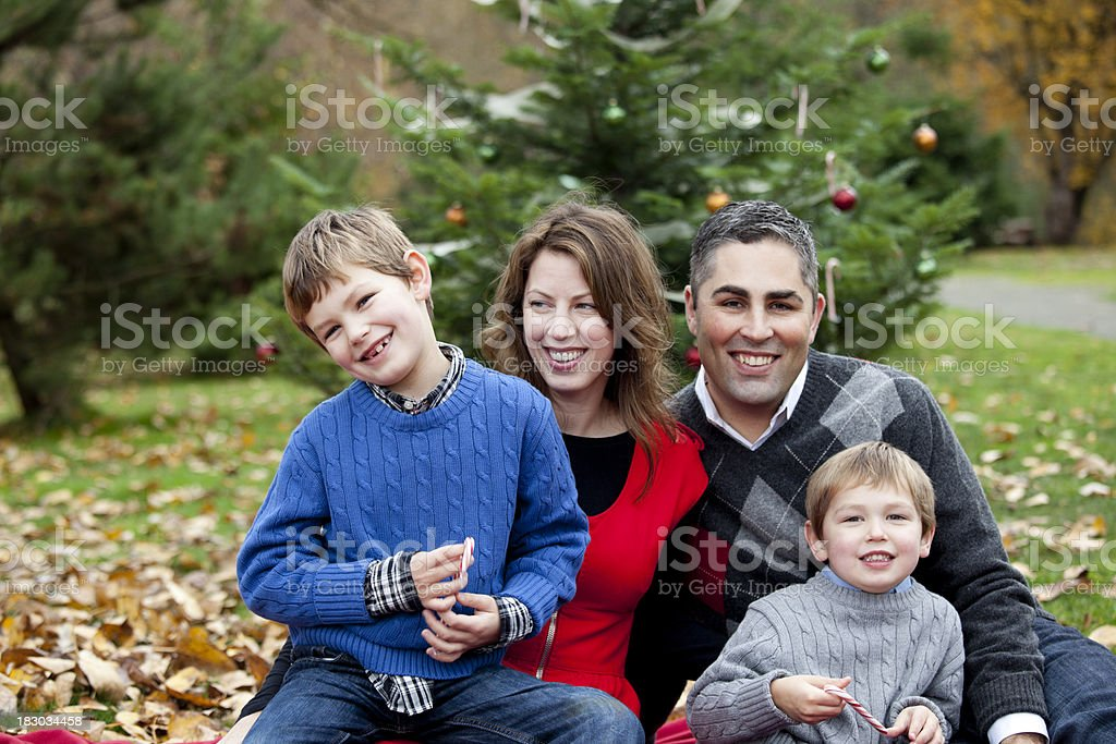 Outdoor Family Portrait; Mother, Father and Two Sons at Christmas stock photo