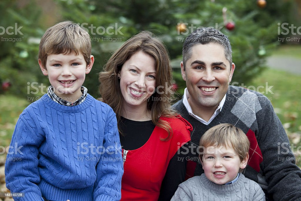 Outdoor Family Portrait; Mother, Father and Two Sons at Christmas royalty-free stock photo