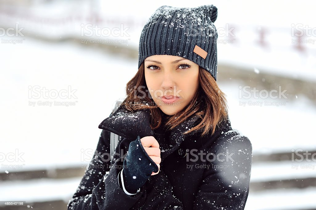 Outdoor fashion portrait of pretty young girl in winter stock photo