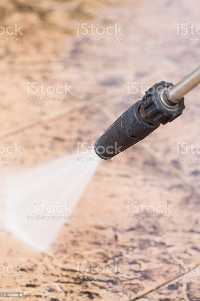 Outdoor floor cleaning with high pressure water stock photo
