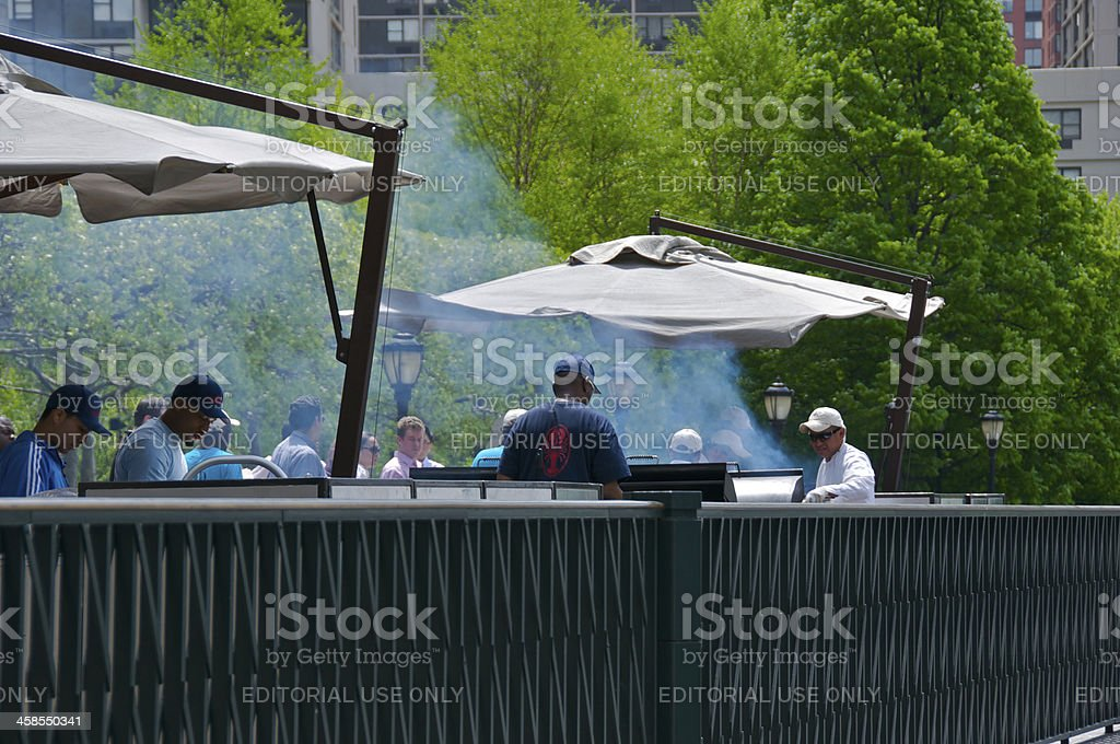 Outdoor food plaza grilling, Lower Manhattan, New York City stock photo
