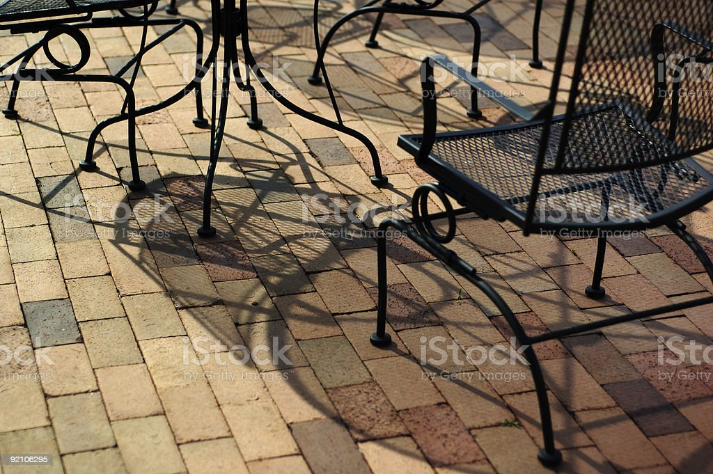 outdoor furniture and shadows royalty-free stock photo
