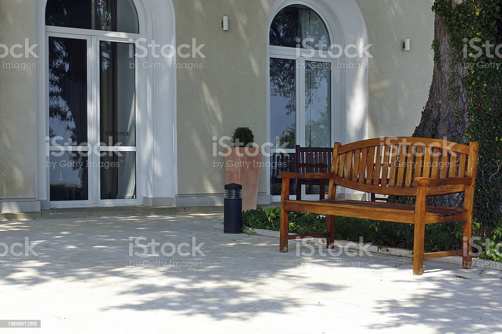 Outdoor furniture. One wooden bench. stock photo