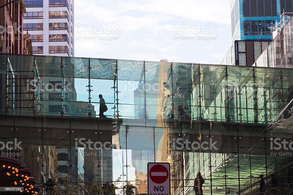 Outdoor glass corridor ower the street between two building royalty-free stock photo