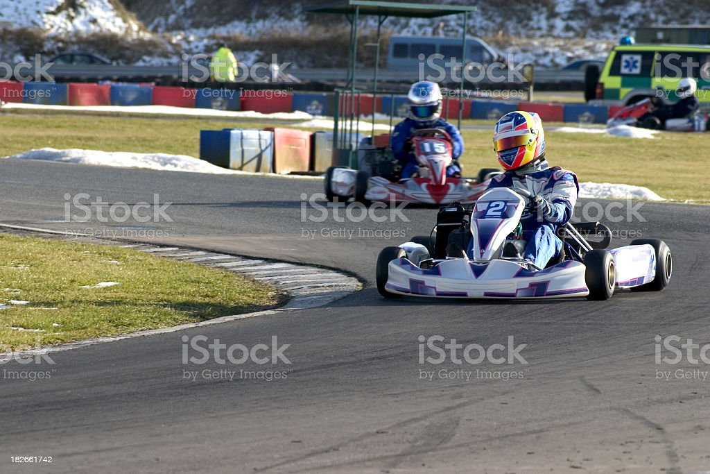Outdoor go-kart racing with small snow piles laying around stock photo