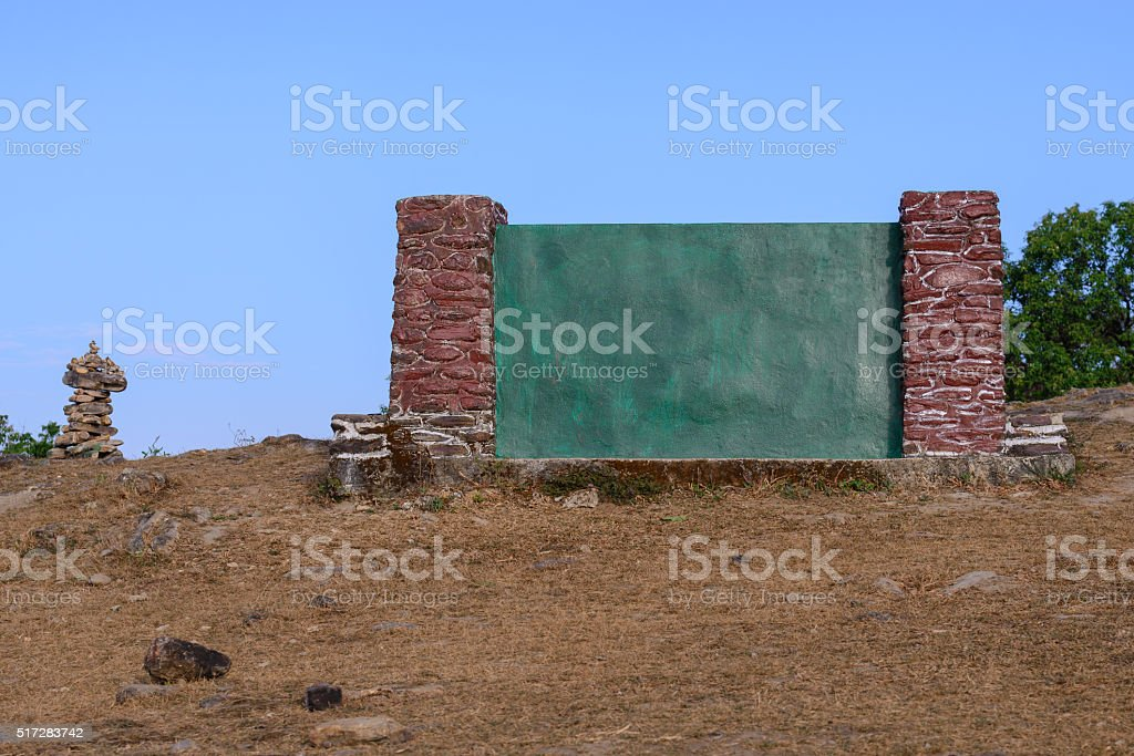 Outdoor green concrete backdrop among nature. stock photo