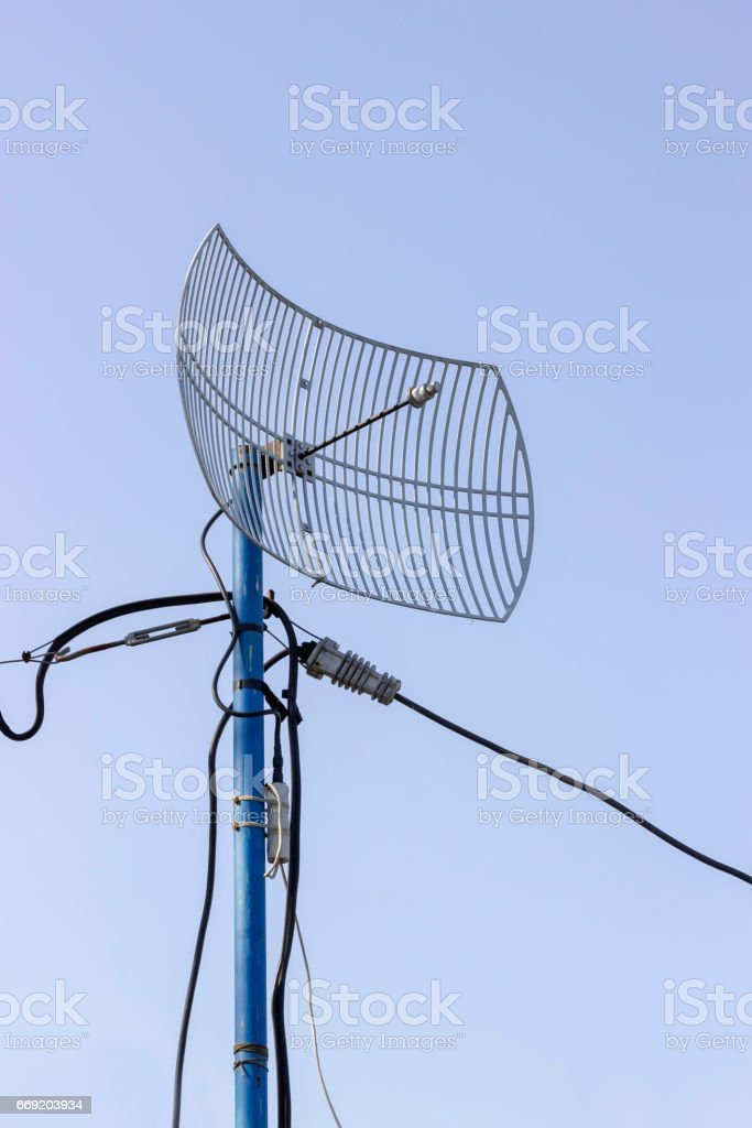 Outdoor grid wireless parabolic directional antenna stock photo