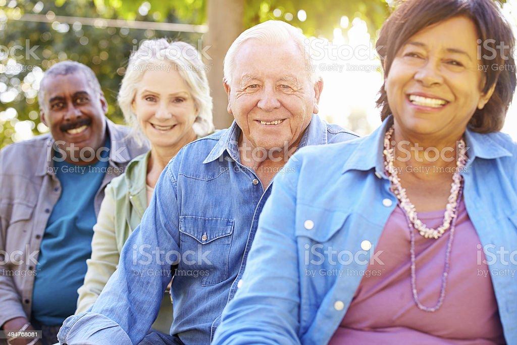 Outdoor Group Portrait Of Senior Friends stock photo