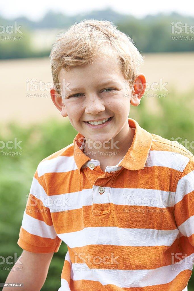 Outdoor Head And Shoulder Portrait Of Boy stock photo