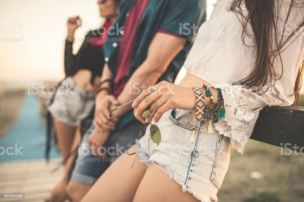 Outdoor high fashion portrait of young adults stock photo