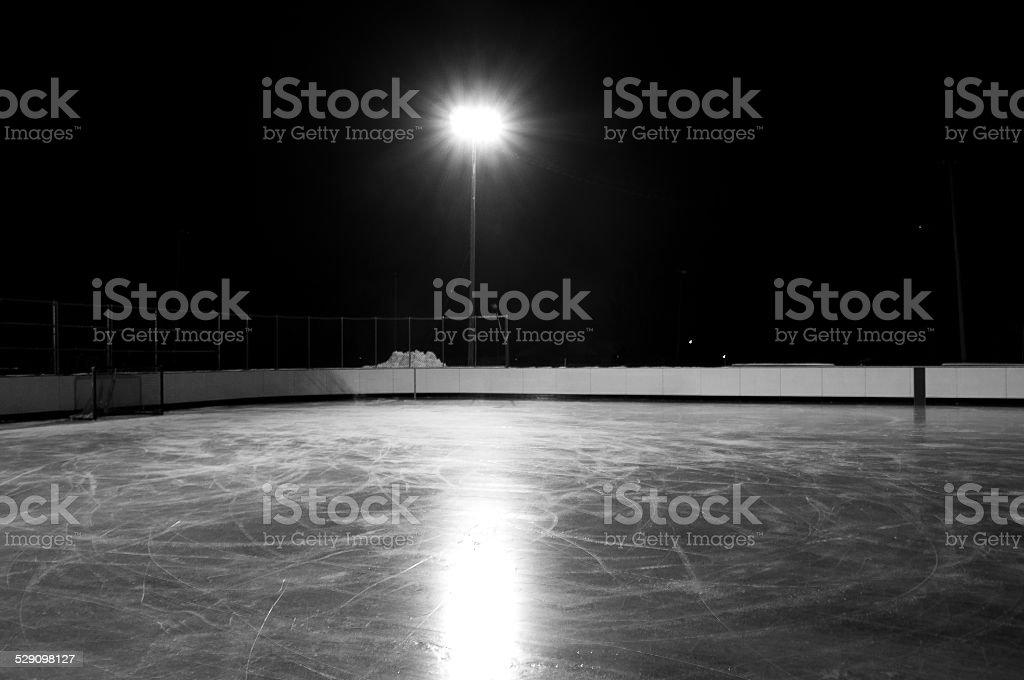 Outdoor hockey rink at night stock photo