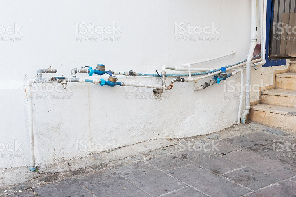 Outdoor home water meters stock photo