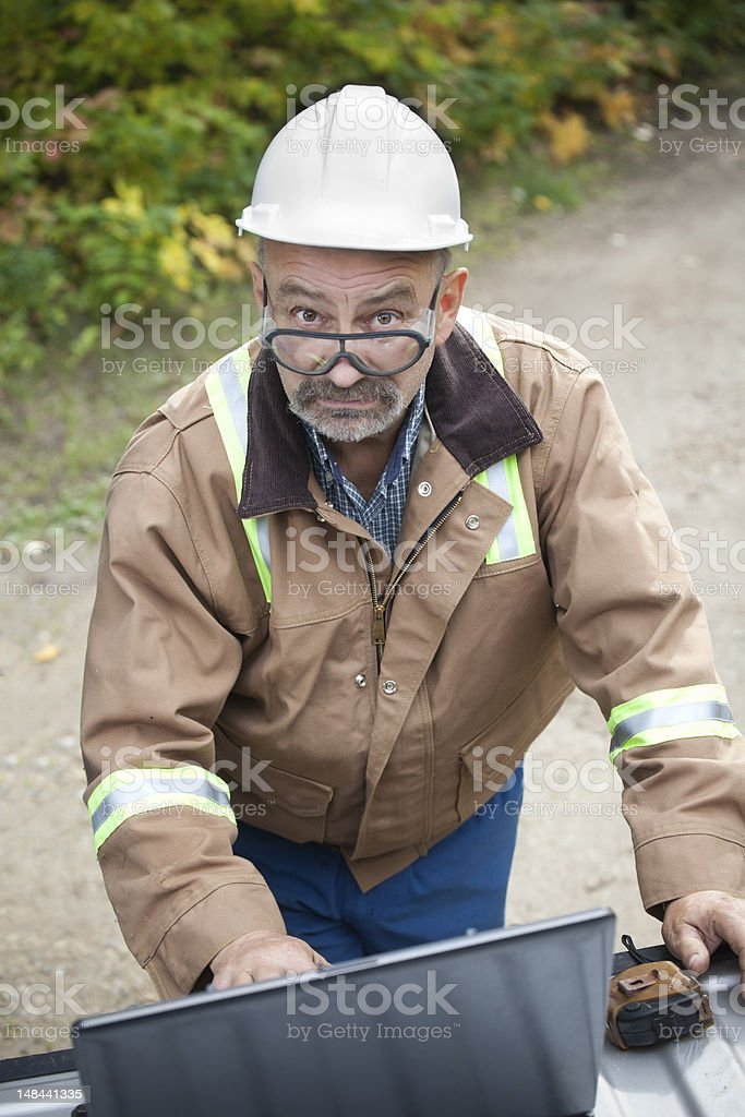 Outdoor Industrial Worker With Laptop royalty-free stock photo
