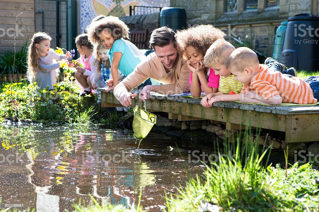 Outdoor Lesson On Pond Life stock photo