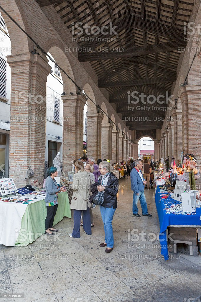 Outdoor market in old fish market gallery in Rimini, Italy. stock photo