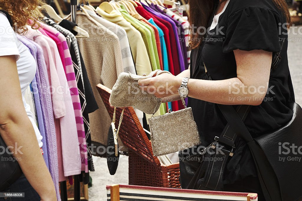 Outdoor market with second hand clothes. royalty-free stock photo