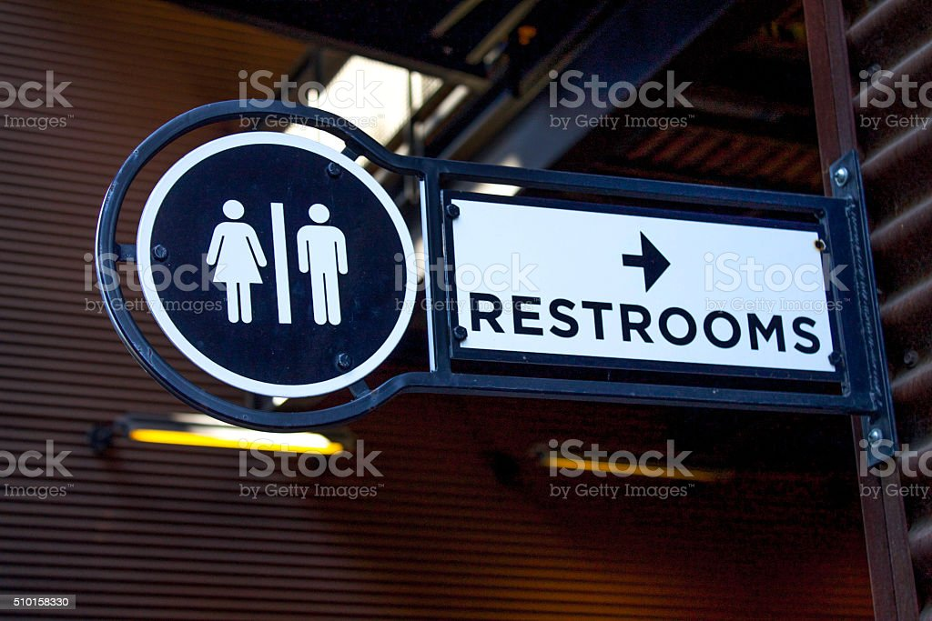 Outdoor Metalic Restroom Sign Close Up stock photo