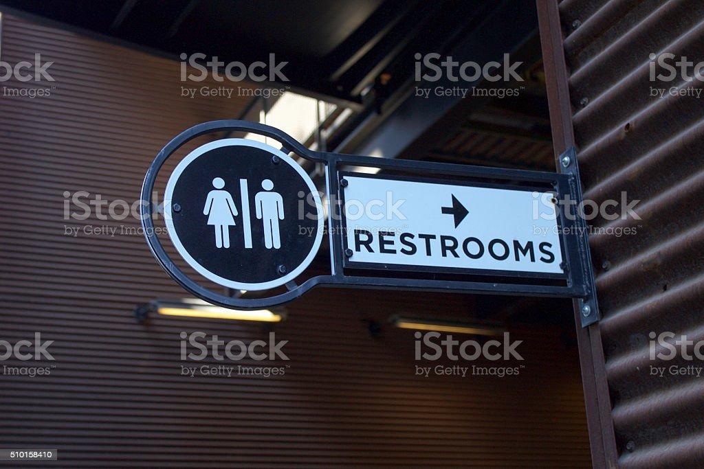 Outdoor Metalic Restroom Sign stock photo