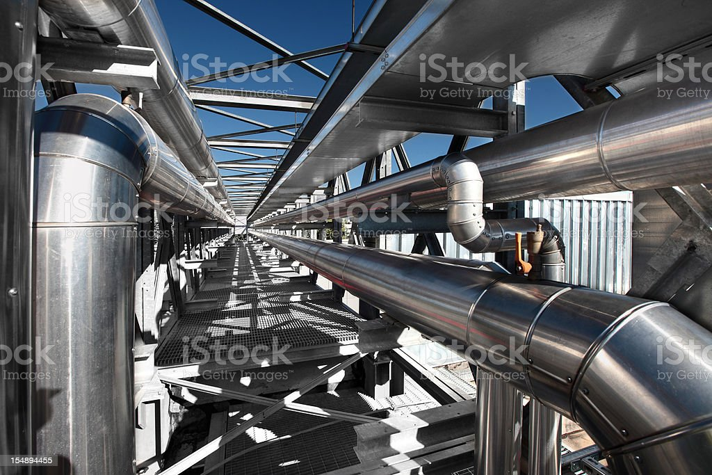 Outdoor metallic gray pipes of an air conditioning system stock photo
