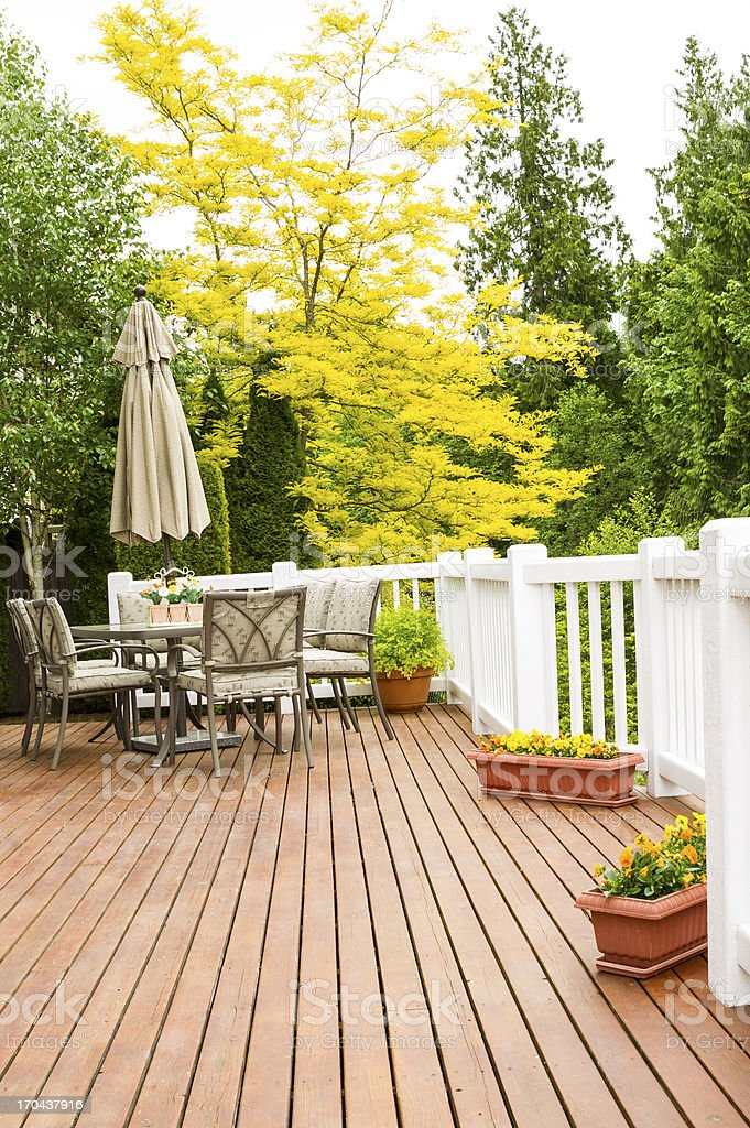 Outdoor Natural Cedar Deck with patio furniture stock photo
