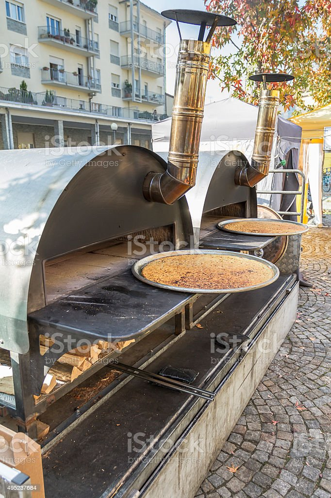 Outdoor ovens for cooking Farinata stock photo