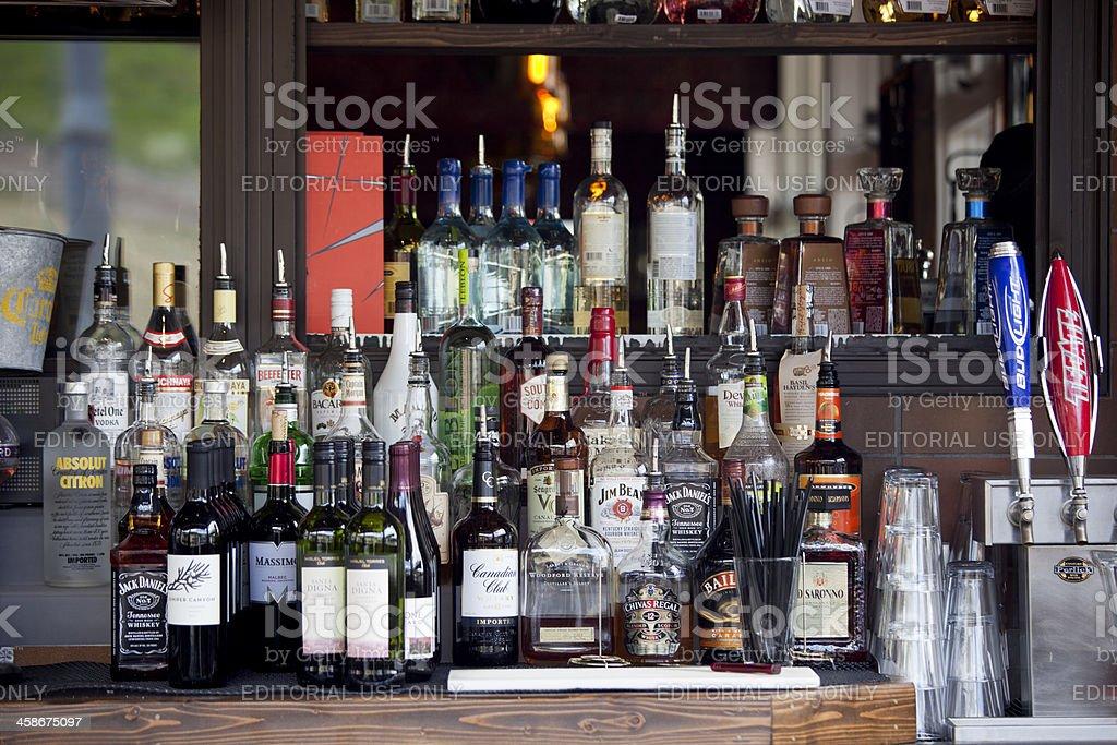 Outdoor patio bar liquor bottles stock photo