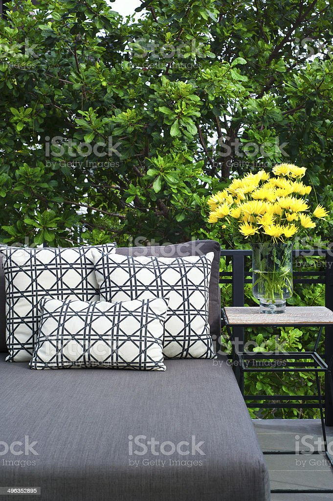 Outdoor patio seating with daybed stock photo