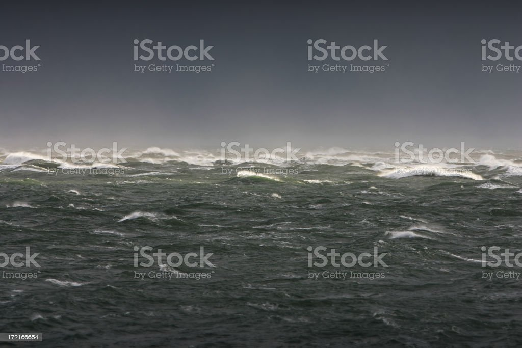 Outdoor photo of waves crashing in distance stock photo