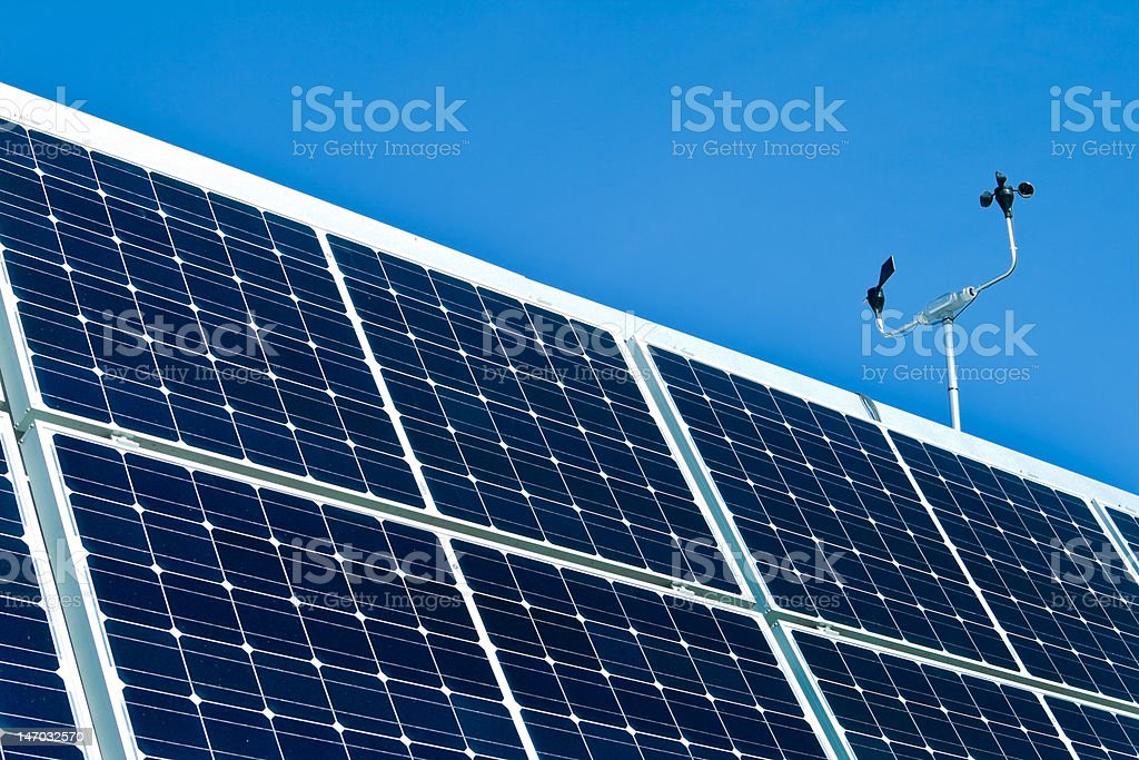 Outdoor Photovoltaic PV Solar Panels, Anemometer, Blue Sky royalty-free stock photo