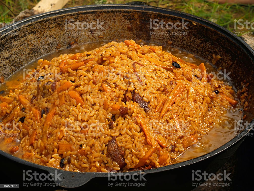 outdoor picnic pilau on the fire stock photo