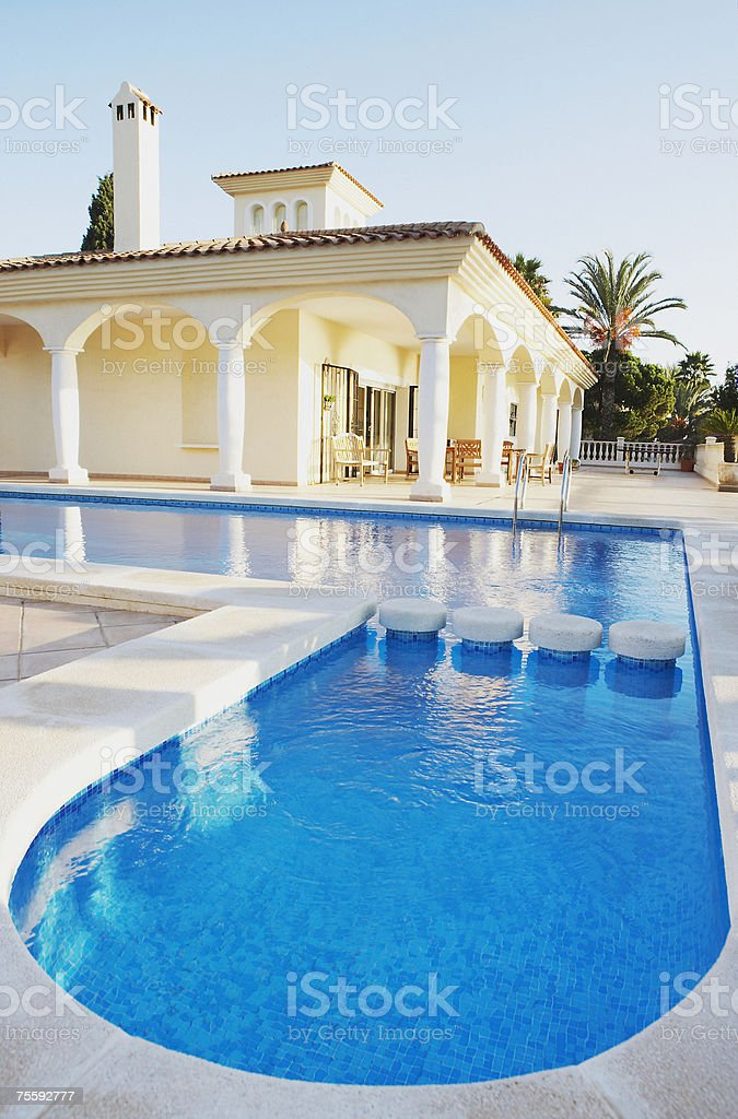 Outdoor pool and building with pillars royalty-free stock photo