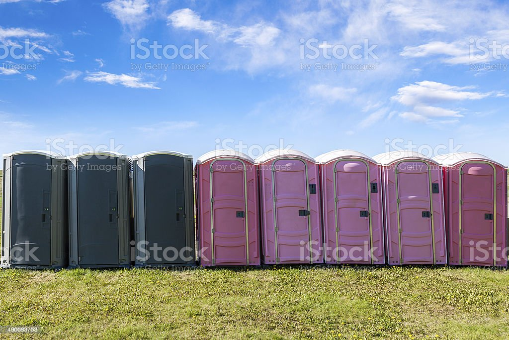 Outdoor Portable Toilets on an Open Field stock photo