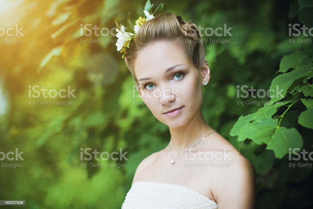 Outdoor portrait of a cute girl with flowers in hair stock photo