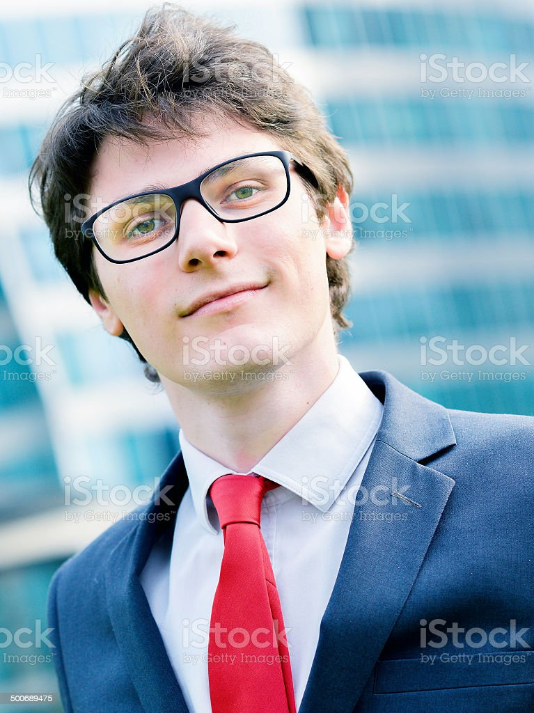 Outdoor portrait of a dynamic junior executive smiling royalty-free stock photo