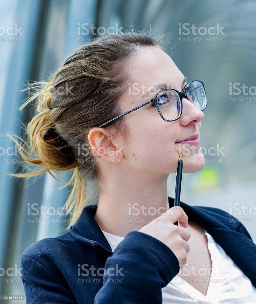 Outdoor portrait of a dynamic junior executive thinking royalty-free stock photo