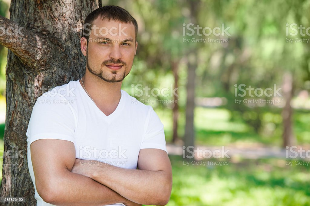Outdoor portrait of a good looking young man stock photo