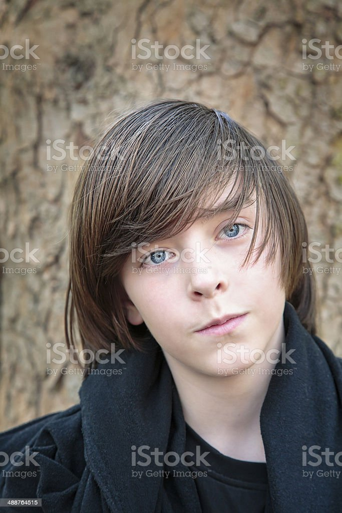 outdoor portrait of a male teenager stock photo