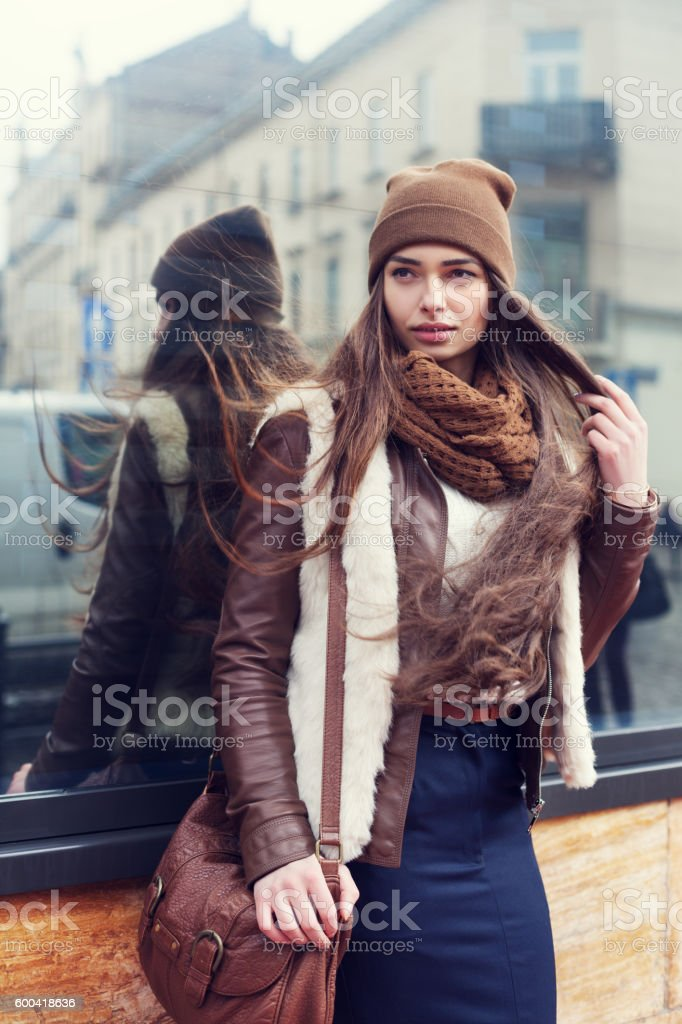 Outdoor portrait of a young beautiful woman wearing stylish clothes stock photo