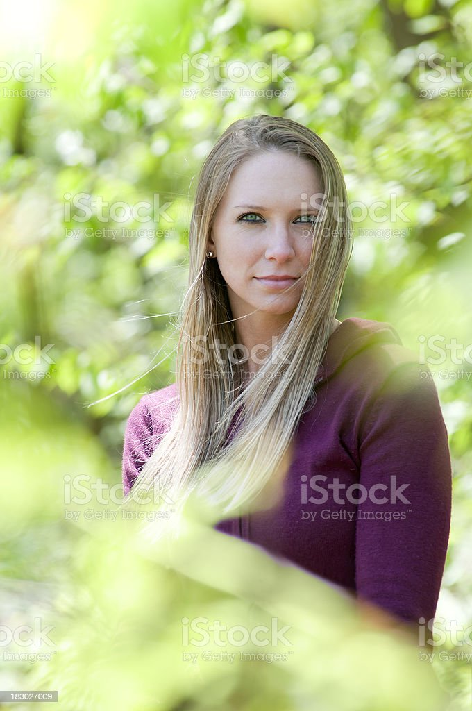 Outdoor portrait of attractive young woman with a long hair stock photo