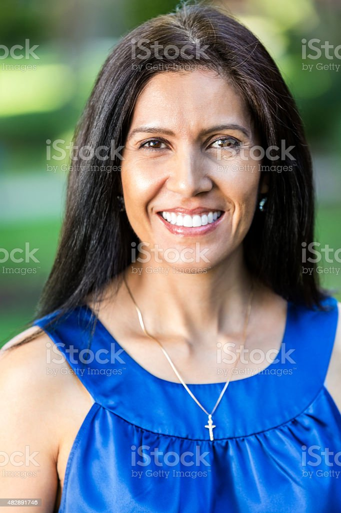 Outdoor portrait of beautiful mature Hispanic woman stock photo