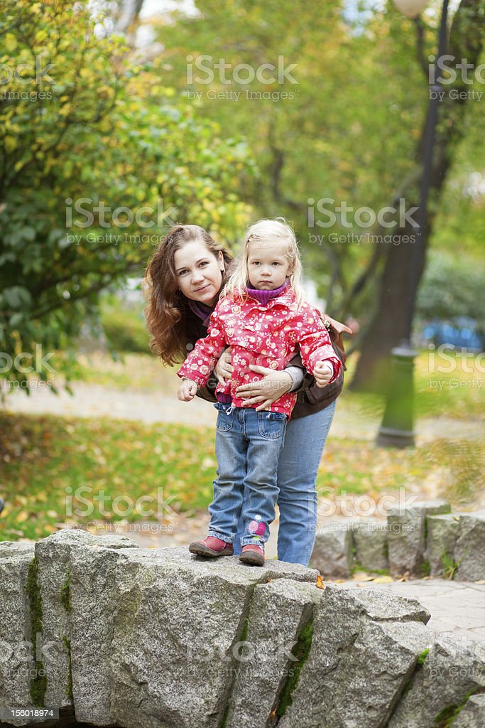 Outdoor portrait of beautiful mother and daughter royalty-free stock photo