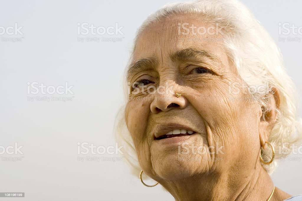 Outdoor portrait of cheerful senior Asian Indian woman lady female royalty-free stock photo