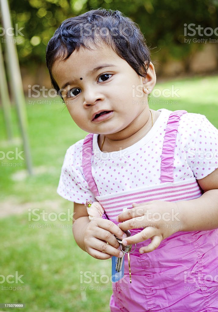 Outdoor Portrait of Cute Little Pensive Indian Girl royalty-free stock photo