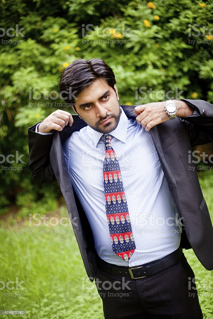 Outdoor Portrait of Handsome Asian Indian Man Getting Dressed royalty-free stock photo