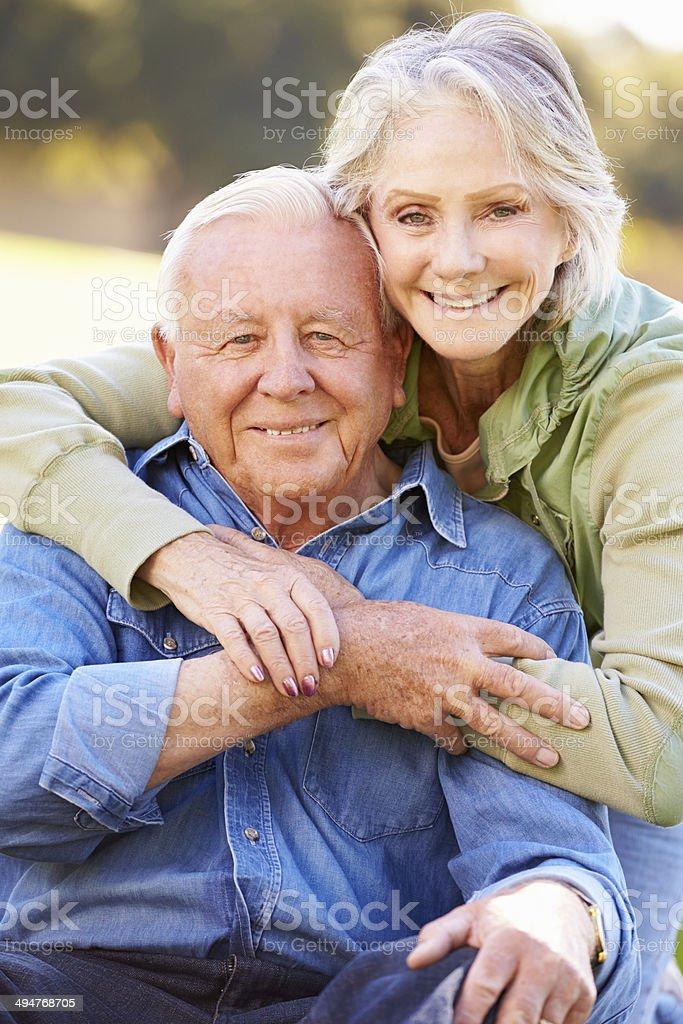 Outdoor Portrait Of Loving Senior Couple stock photo
