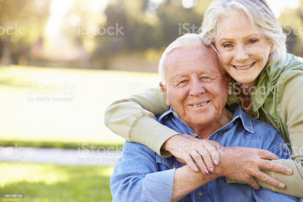 Outdoor Portrait Of Loving Senior Couple stock photo