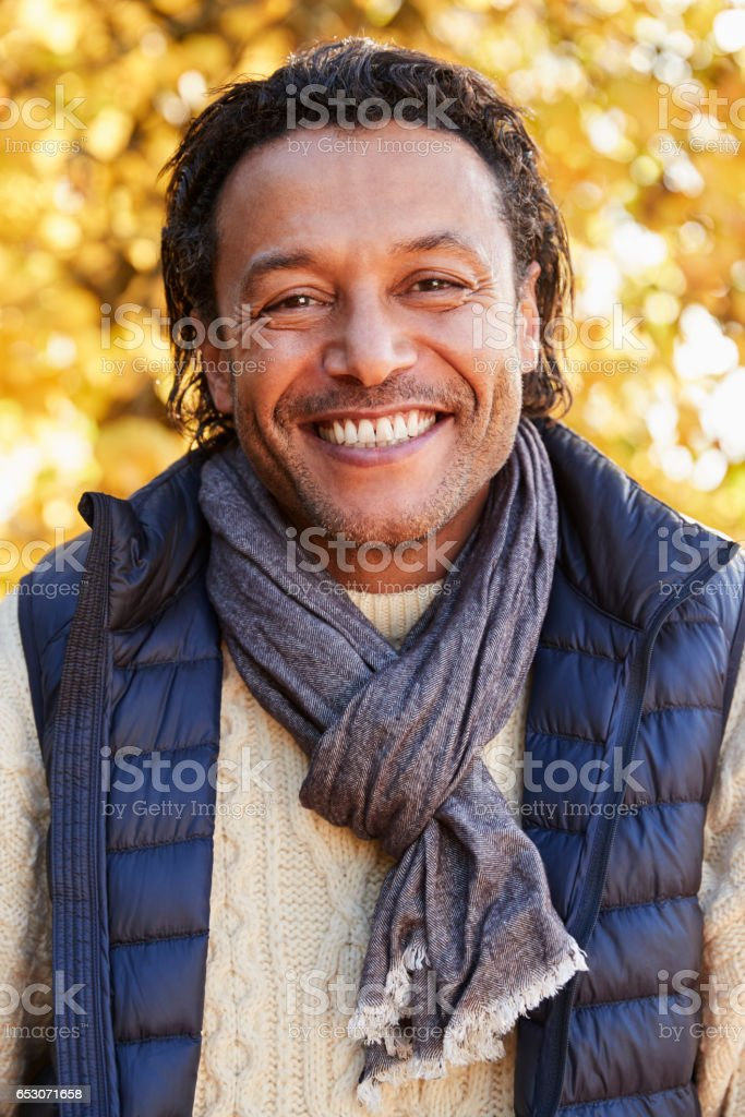 Outdoor Portrait Of Mature Man Wearing Scarf In Autumn stock photo