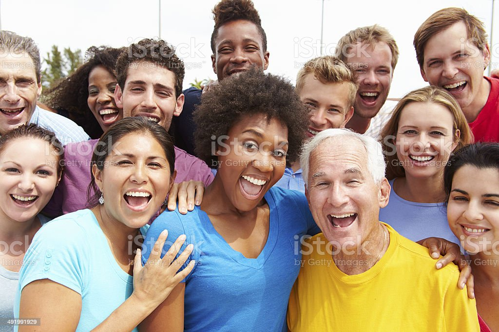 Outdoor Portrait Of Multi-Ethnic Crowd Smiling To Camera
