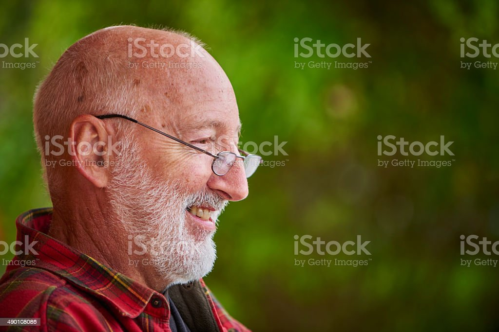 Outdoor portrait of retired man. stock photo